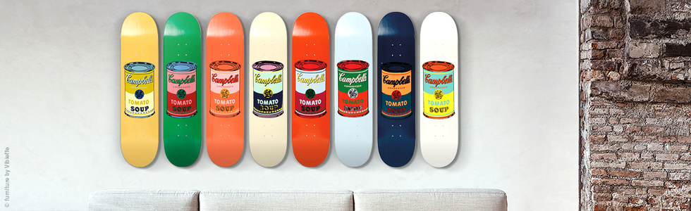 Complementary colours in these Warhol skateboards liven up the room.